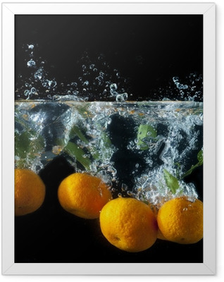 Orange splash Framed Poster