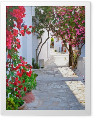 Quiet back street in small traditional greek village Framed Poster