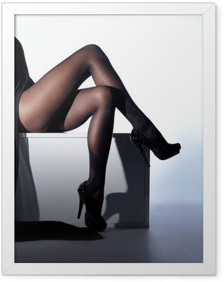Sexy female legs in black erotic stockings and high heels Framed Poster