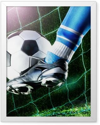 Foot kicking soccer ball Framed Poster