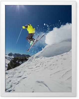 Alpine skier jumping from hill Framed Poster
