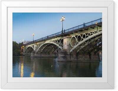 Poster en cadre Pont de Triana, le plus vieux pont de Séville au crépuscule - Europe