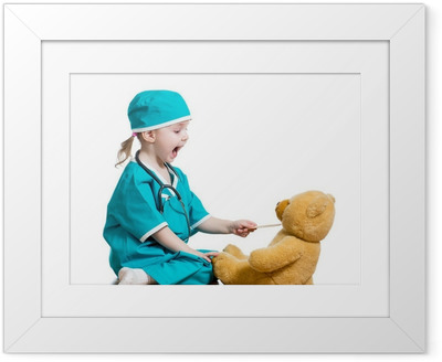 Adorable child dressed as doctor playing with toy over white Framed Poster