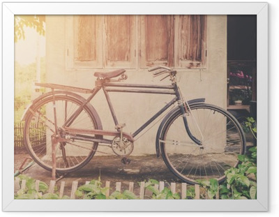 Vintage bicycle or old bicycle vintage park on old wall home. Framed Poster