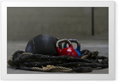 Kettle bells, rope and a medicine ball used for crossfit Framed Poster