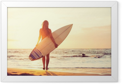Surfer girl on the beach at sunset Framed Poster