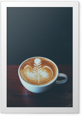 cup of coffee latte art in coffee shop Framed Poster