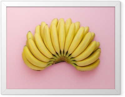Top view of ripe bananas on a bright pink background. Minimal style. Framed Canvas
