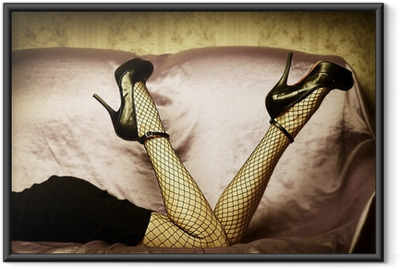 Sexy female legs in shoes Framed Poster