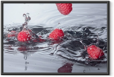 Red Raspberries Dropped into Water with Splash Framed Poster