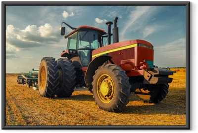 Tractor on the agricultural field Framed Poster