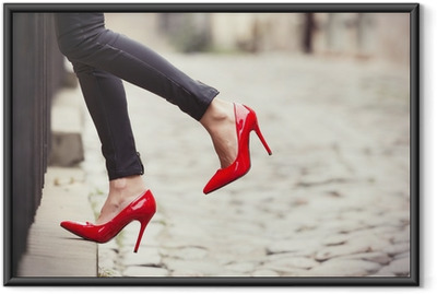 Póster com Moldura Woman wearing black leather pants and red high heel shoes