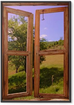 Maiseman näkyy ikkunan läpi Kehystetty juliste