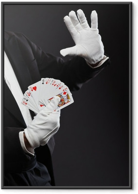 Hands of magician holding cards. Wearing black suit. Studio shot Framed Poster