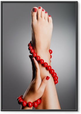 Closeup photo of a beautiful female feet with red pedicure Framed Poster