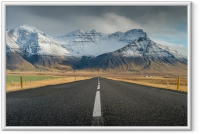 Perspective road with snow mountain range background in cloudy day autumn season Iceland Framed Poster