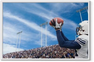 American Football Player catching a touchdown pass Framed Poster