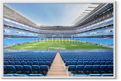 Empty outdoor football stadium with blue seats Framed Poster