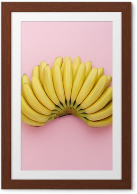 Top view of ripe bananas on a bright pink background. Minimal style. Framed Poster