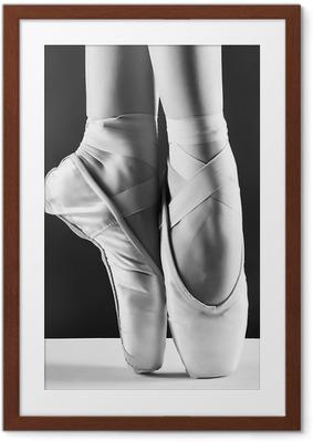 Póster com Moldura A photo of ballerina's pointes on black background
