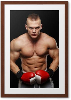 Ingelijste Poster Gespierde knappe jonge man met bokshandschoenen