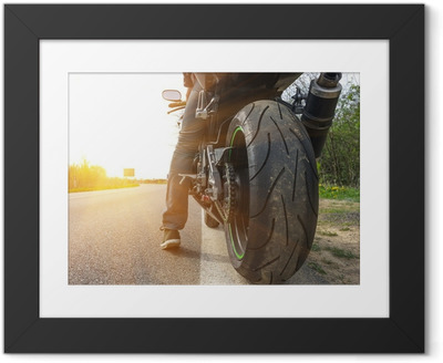 motorbike on the side of the street Framed Poster