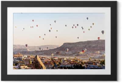 932914f8 Hot air balloon flying over valleys in Cappadocia Turkey Framed Poster