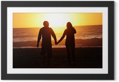 loving couple beach sunset Framed Poster