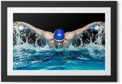 Muscular young man in blue cap in swimming pool Framed Poster