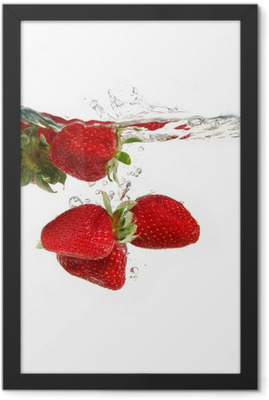 strawberries in water Framed Poster