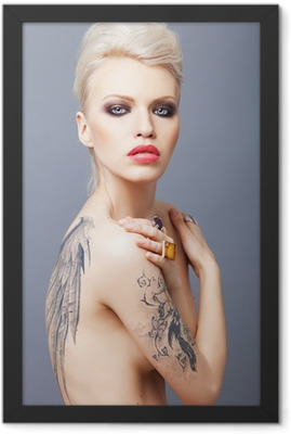 Vamp looking woman with tattoo wings on the back Framed Poster