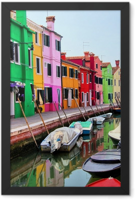 Colorful houses along a canal in Burano, near Venice, Italy Framed Poster