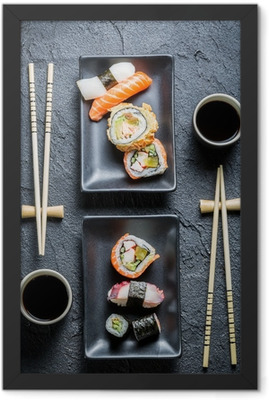 Sushi for two served on black stone Framed Poster