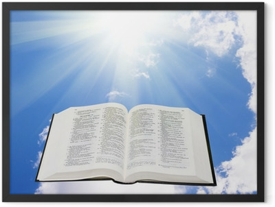 Holy bible in the sky illuminated by a sunlight Framed Poster