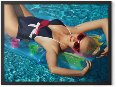 Pin up girl in the swimming pool Framed Poster