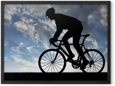 silhouette of the cyclist riding a road bike at sunset Framed Poster