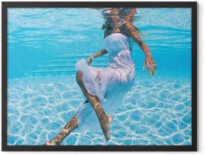Underwater woman portrait with white dress in swimming pool. Framed Poster