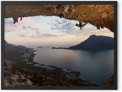 Silhouette of a rock climber at sunset. Kalymnos Island, Greece. Framed Poster