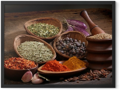 Different spices over a wood background. Framed Poster
