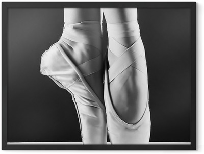 A photo of ballerina's pointes on black background Framed Poster