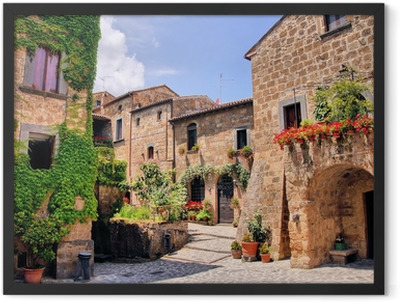 Picturesque corner of a quaint hill town in Italy Framed Poster