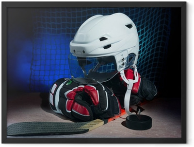 Hockey gloves,helmet and stick lay on ice. Framed Poster