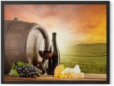 Red wine still life with vineyard on backgorund Framed Poster