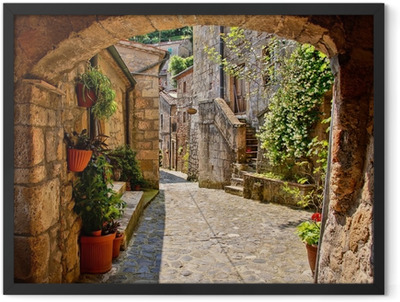 Arched cobblestone street in a Tuscan village, Italy Framed Poster