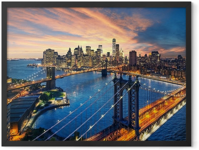 Sunset over the Manhattan and Brooklyn bridge Framed Poster