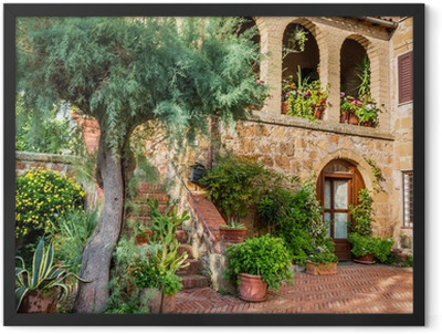 Beautiful porch in a small city in Tuscany Framed Poster