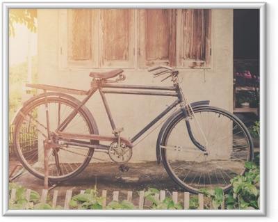 Vintage bicycle or old bicycle vintage park on old wall home. Framed Poster