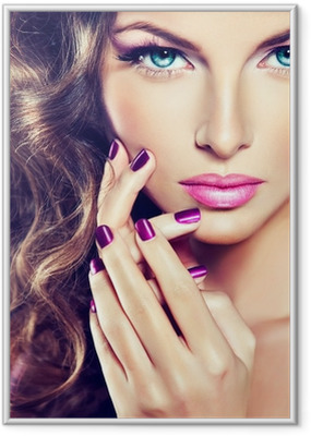beautiful model with curly hair and purple manicure Framed Poster
