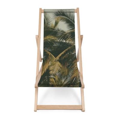Leżak plażowy Sylwetka palmy w tle rocznika filtra