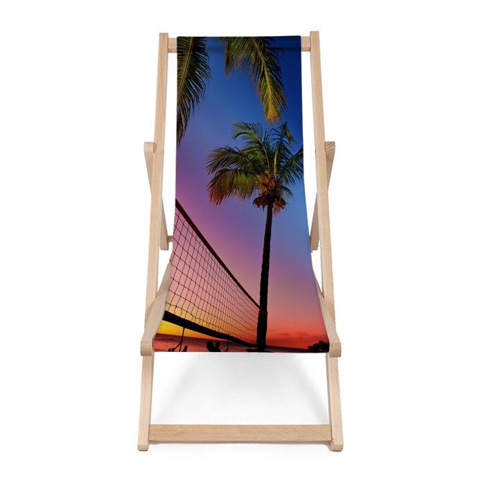 Leżak plażowy Siatka do siatkówki plażowej pomiędzy palmami na zachodzie słońca - Siatkówka